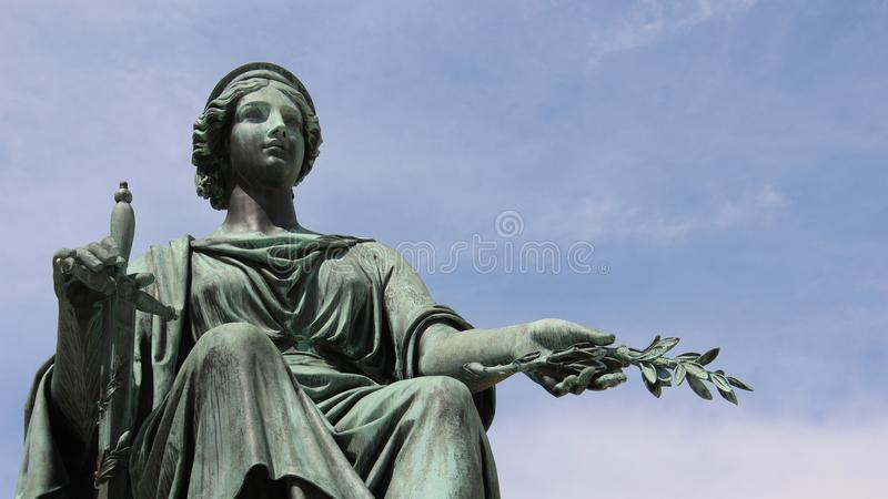 Sculpture Woman Holding Olive Leaf royalty free stock image