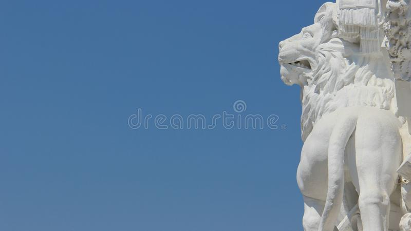 Sculpture And Art One White Lion With Blue Sky Backgrounds royalty free stock photography