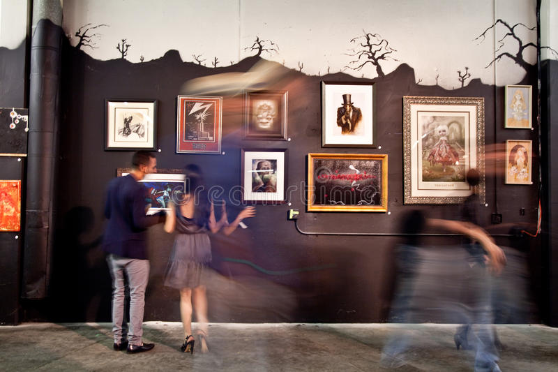Art Show. Passers by at an art show royalty free stock images