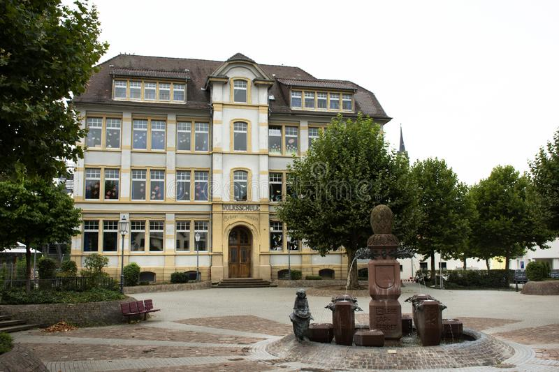 Art statue and fountain at front of Theodor Heuss primary school at Sandhausen village in Heidelberg, Germany stock image