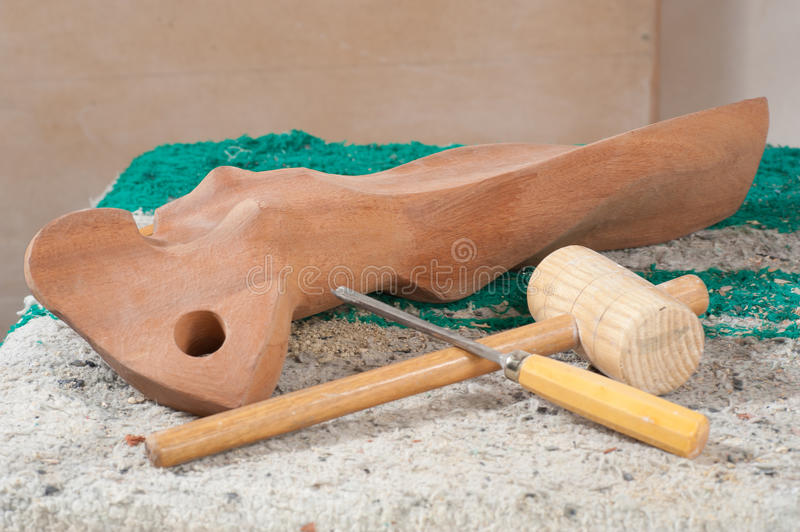 Art still life. A wooden scultpure and work tools, still life royalty free stock photos