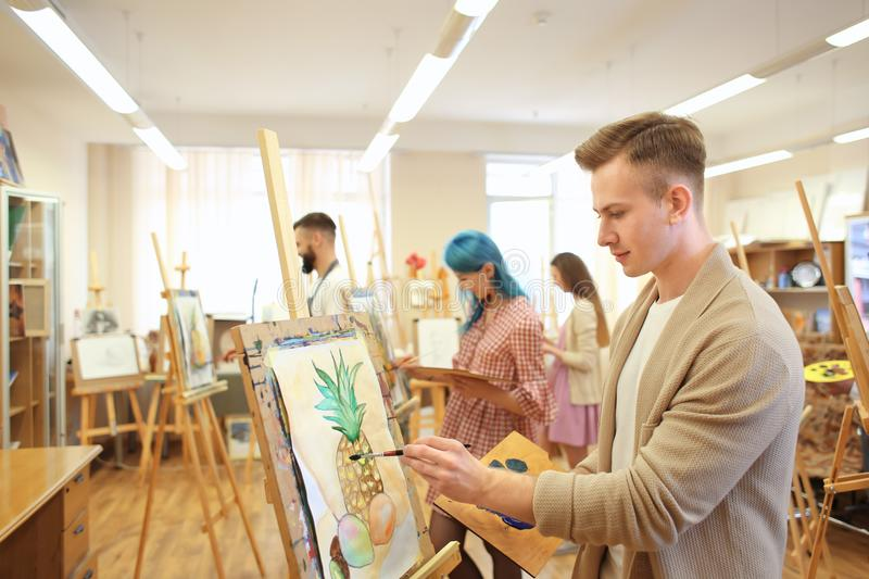 Art students painting in workshop stock photos