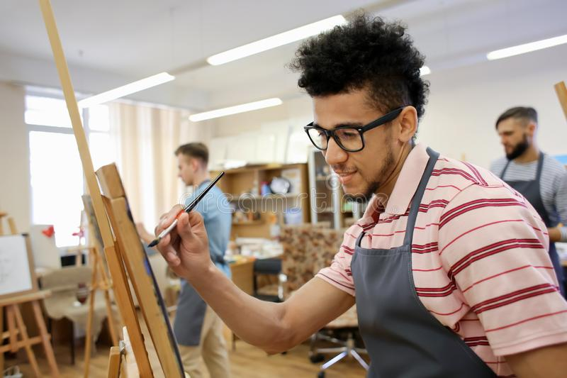Art students painting in workshop stock photo