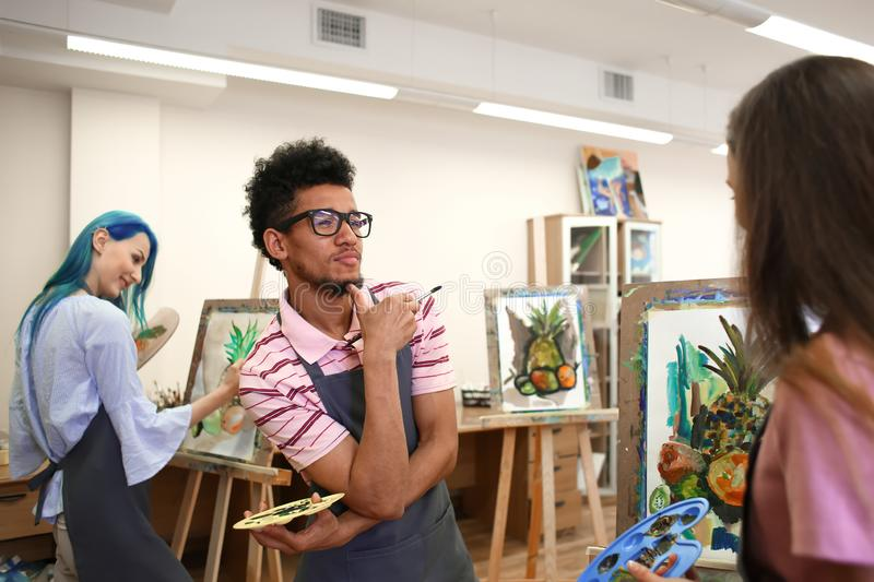 Art students painting in workshop stock image