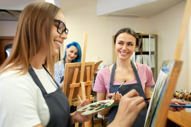 Art students painting in workshop stock photography