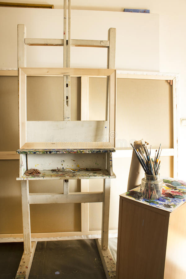 Art Studio with an Easel and Blank Canvases.  stock photo