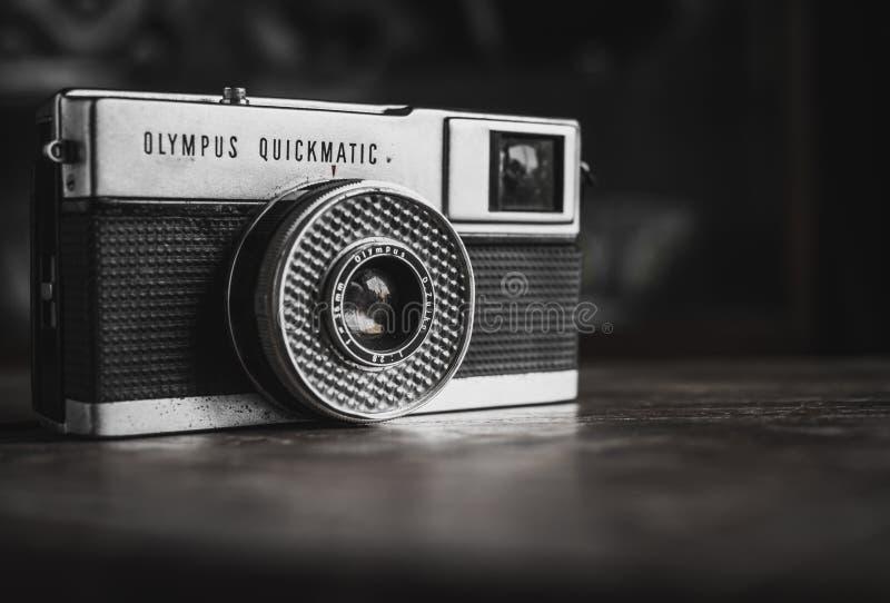 Vintage Camera. 56 ART STUDIO, NAKHONSAWAN, THAILAND - April 13, 2018 : Old Vintage Olympus Camera on Wooden Background royalty free stock photography