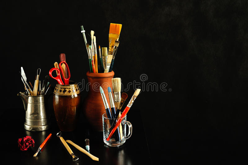 Art studio. Still life on black background royalty free stock images
