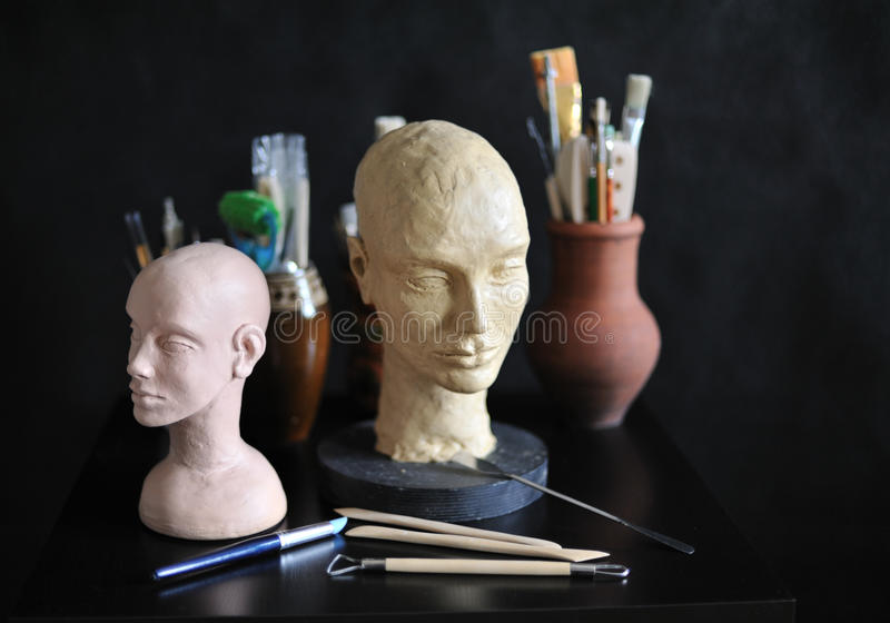 Art studio. Still life with sculpture and art supplies royalty free stock photography