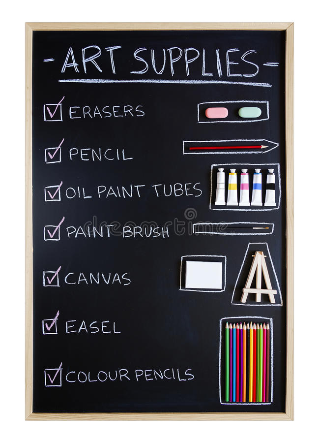 Art supplies over blackboard background royalty free stock images