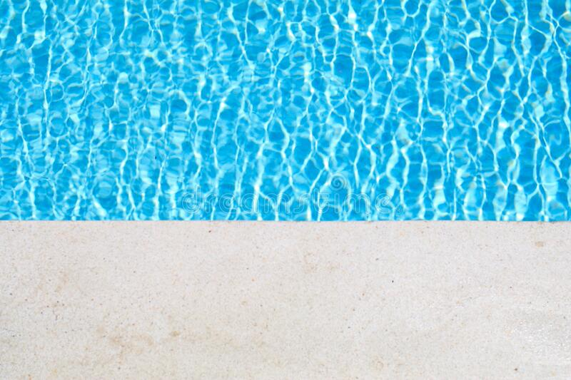 Art of swimming pool with blue water.Swimming pool bottom caustics ripple and flow with waves background. Summer background. Texture of water surface. Overhead royalty free stock photos