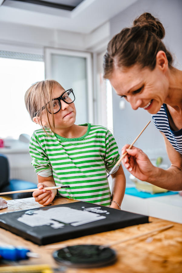 Art teacher helping a student with painting royalty free stock images