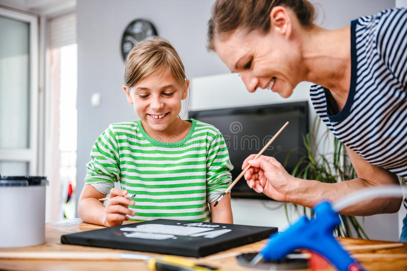 Art teacher helping a student with painting royalty free stock photos