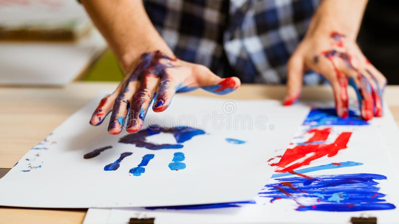 Art therapy school paint hand print paper stock images
