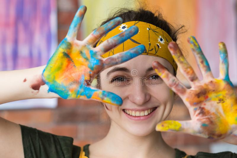 Art therapy portrait female artist fun smiling stock photo