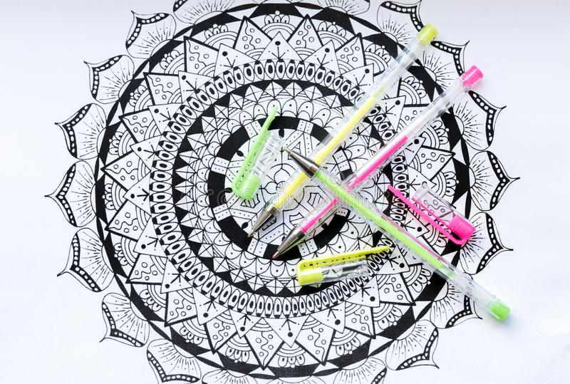 Art therapy, mental health, creativity and mindfulness concept. Adult coloring page with pastel colored gel pens, Flat lay. stock images