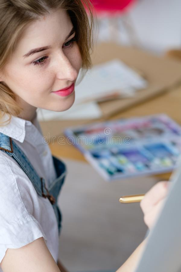 Art therapy painting class watercolor woman draw. Art therapy. painting classes or courses. creativity inspiration expression concept. woman drawing a picture royalty free stock photography