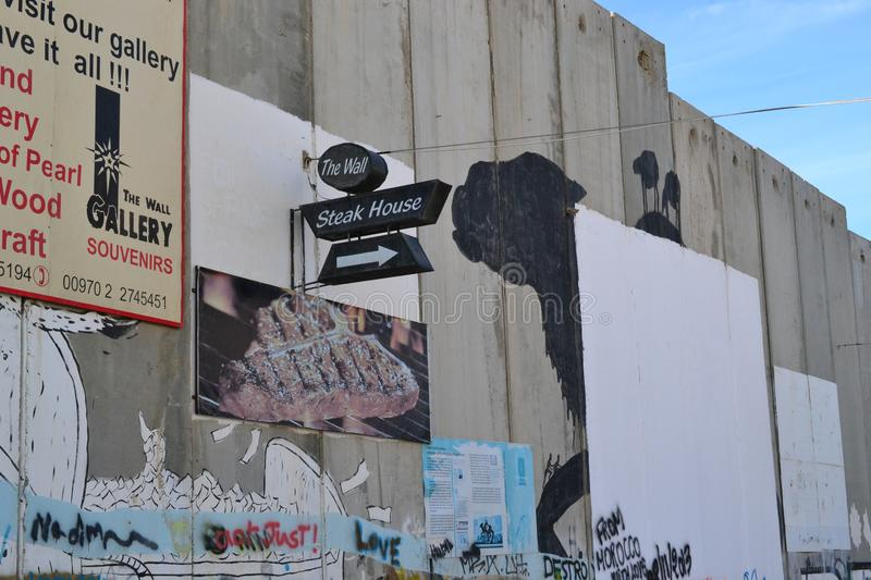 Art and writings on the wall in Bethlehem, between Palestine Westbank and Israel. Art on the wall in Bethlehem, between Palestine Westbank and Israel royalty free stock photo