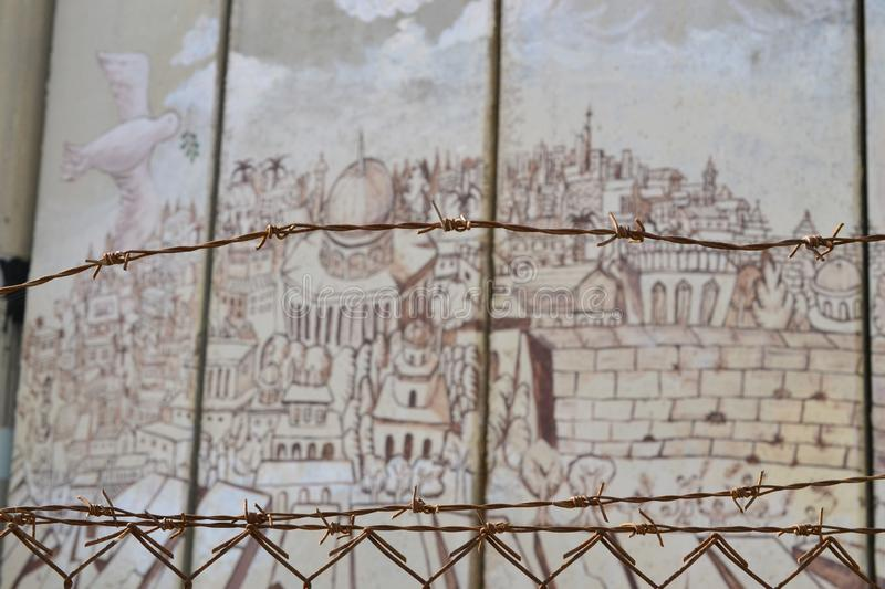 Barbed fence, old city of Jerusalem, Art and writings on the wall in Bethlehem, between Palestine Westbank and Israel. Art on the wall in Bethlehem, between stock photos