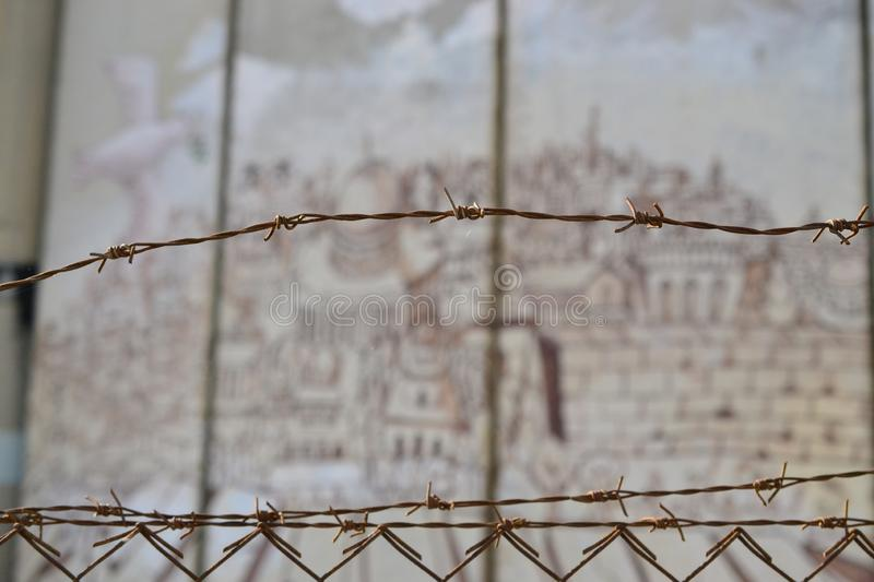 Barbed fence, old city of Jerusalem, Art and writings on the wall in Bethlehem, between Palestine Westbank and Israel. Art on the wall in Bethlehem, between stock image