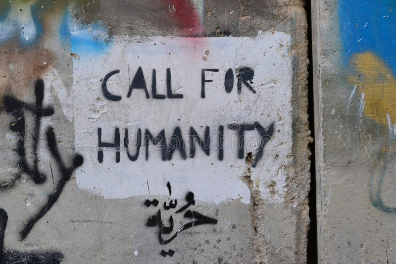 Call for humanity. Art and writings on the wall in Bethlehem, between Palestine Westbank and Israel. Art on the wall in Bethlehem, between Palestine Westbank and stock image
