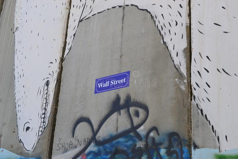 Wall Street. Art and writings on the wall in Bethlehem, between Palestine Westbank and Israel. Art on the wall in Bethlehem, between Palestine Westbank and royalty free stock photos