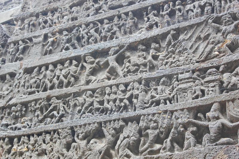 Art on the walls of Ancient stone carved Kailasa temple, Cave No 16, Ellora caves, India stock photos