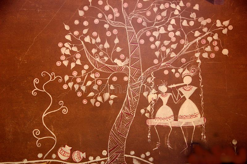 Art Work on Wall at Madhu Vana, Bengaluru. Close-up of brown colored wall painted with fine artwork in white clolor at Madhu Vana near Bengaluru, Karnataka royalty free stock images