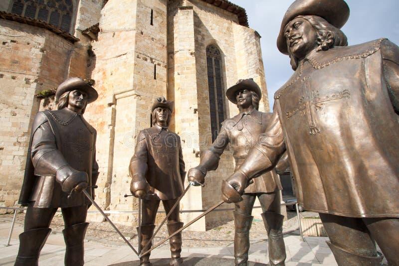 artagnan D-musketeersstatyer tre fotografering för bildbyråer