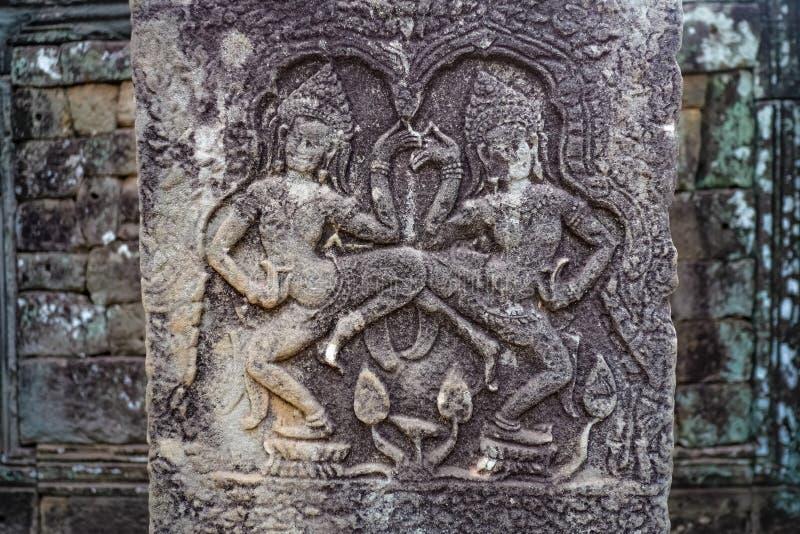 Arte antiga da parede em Angkor Wat Siem Reap cambodia imagem de stock