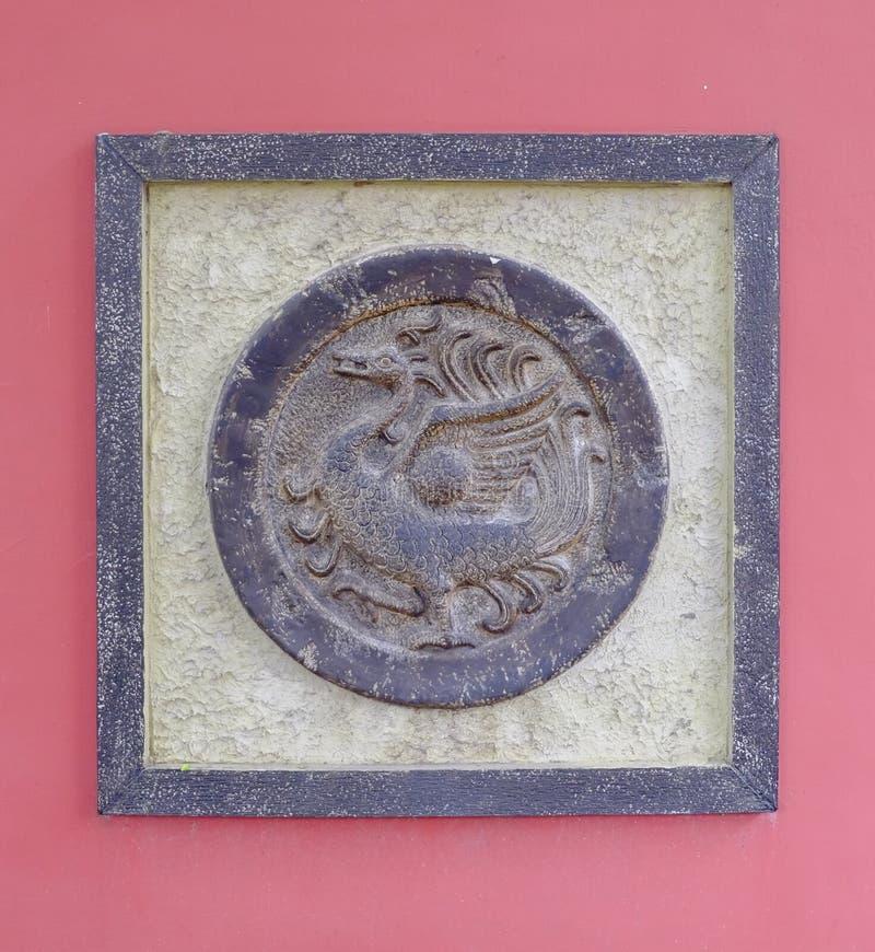 Arte chino, imagen del bajorrelieve del phenix fotos de archivo