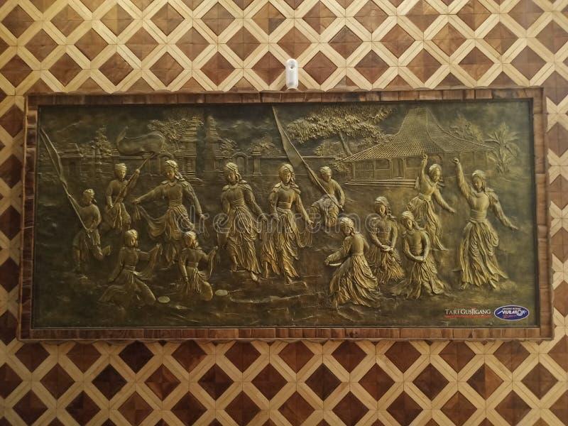 arte colgante de la pared de baile de gusjigang Ciudad de Kudus, Java central, Indonesia fotografía de archivo