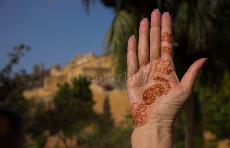 Arte da mão com Amber Fort no fundo imagens de stock royalty free