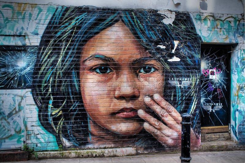 Arte da rua na pista Londres do tijolo fotografia de stock