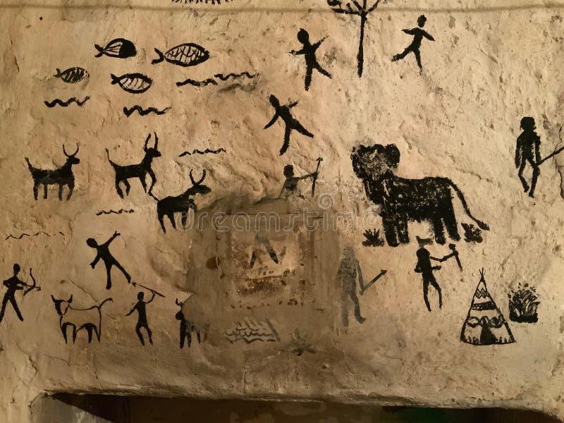 Arte das crianças em pinturas de caverna na parede de pedra ilustração do vetor