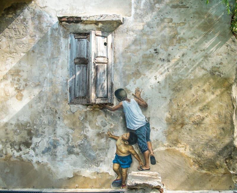 arte de la calle 3D en la pared La pintura de muchachos está jugando cerca de las ventanas foto de archivo libre de regalías