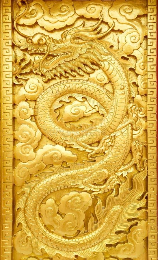 Arte de oro del dragón foto de archivo