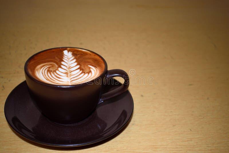 Arte del caffè con la foglia fotografia stock