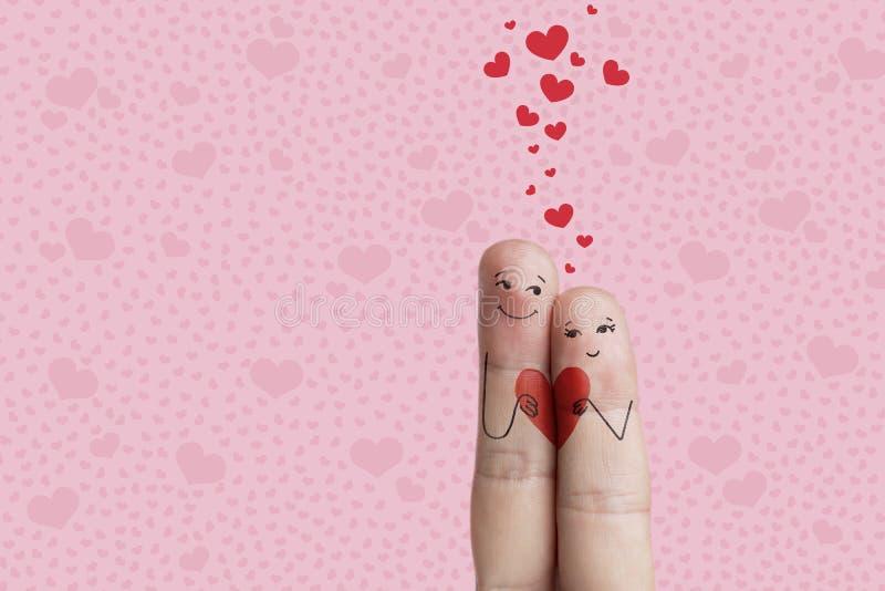 Arte del dito di una coppia felice Gli amanti è abbraccianti e tenenti con riferimento a fotografie stock