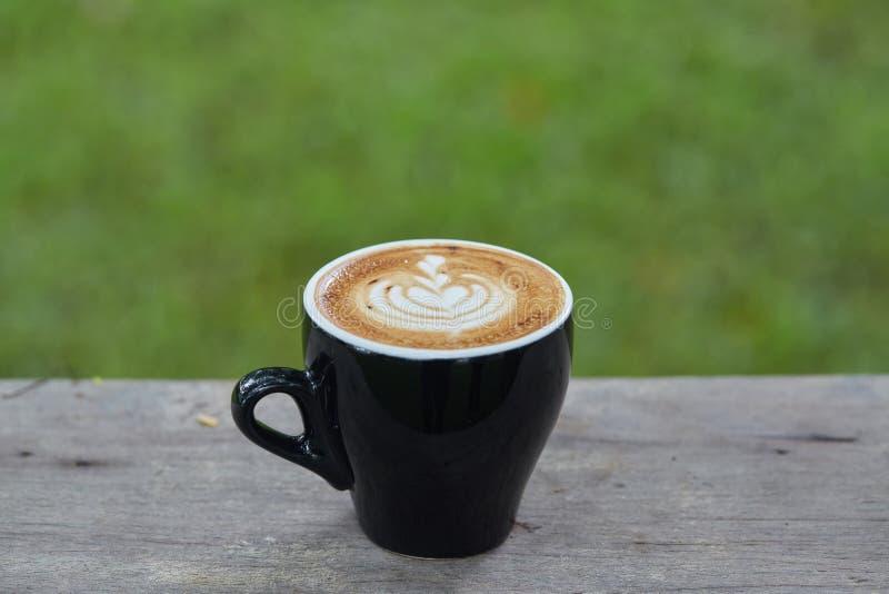 Arte del latte de la taza del café sólo fotografía de archivo libre de regalías