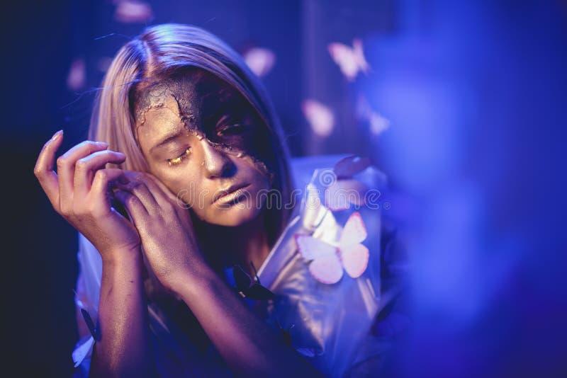 Arte della farfalla della ragazza fotografia stock