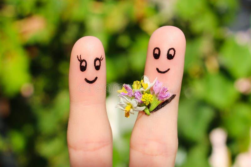 Arte do dedo de um par feliz fotografia de stock