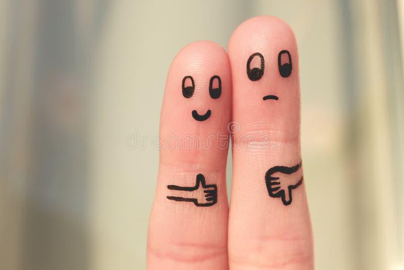 Arte do dedo dos pares Mulher que mostra os polegares acima e o homem que mostra os polegares para baixo foto de stock royalty free