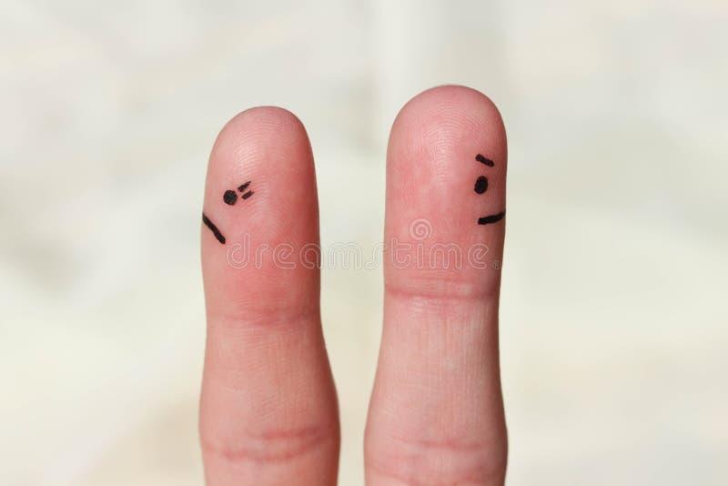 Arte do dedo dos pares Pares após um argumento que olha em sentidos diferentes foto de stock royalty free