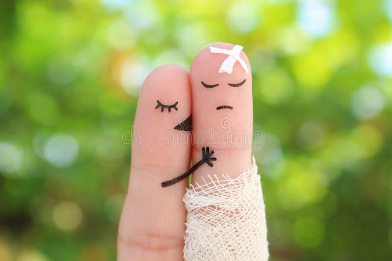 Arte dos dedos de pares desagradados O homem é doente, mulher sente pesaroso para ele imagens de stock