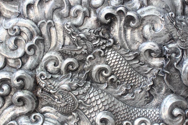 A arte e o teste padrão de cinzelar a pratas imagem de stock