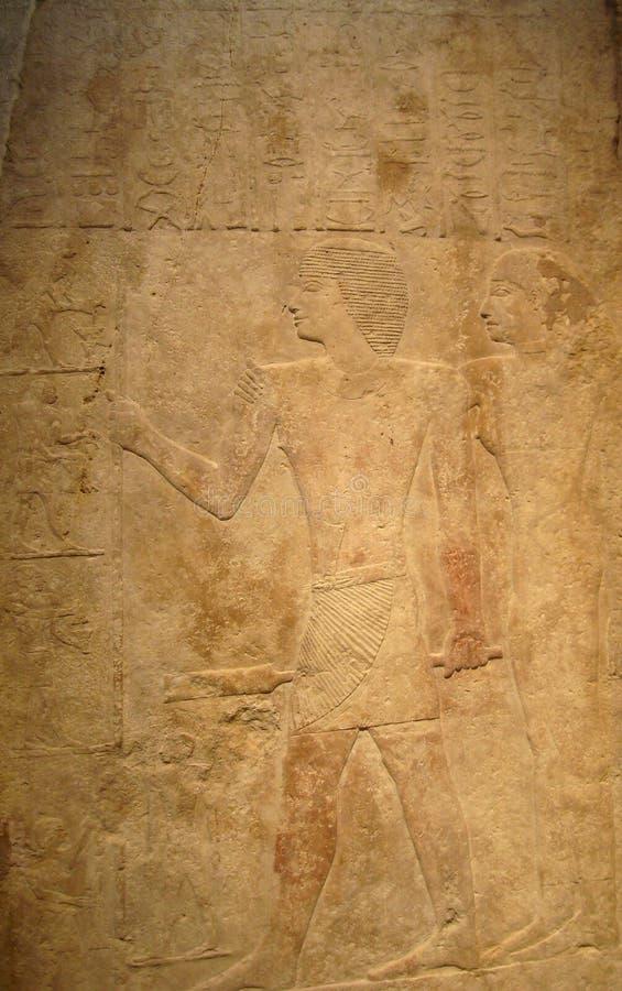 Arte egipcio antiguo del alivio en oro imágenes de archivo libres de regalías