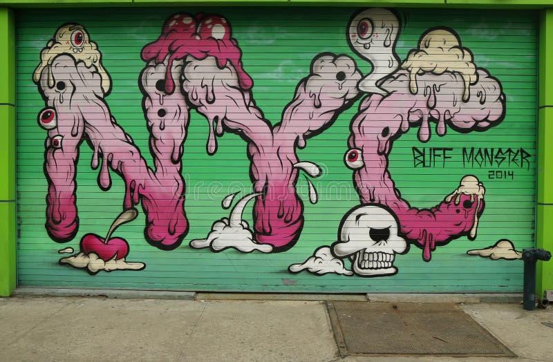 Arte mural por Buff Monster em pouco Itália imagens de stock royalty free