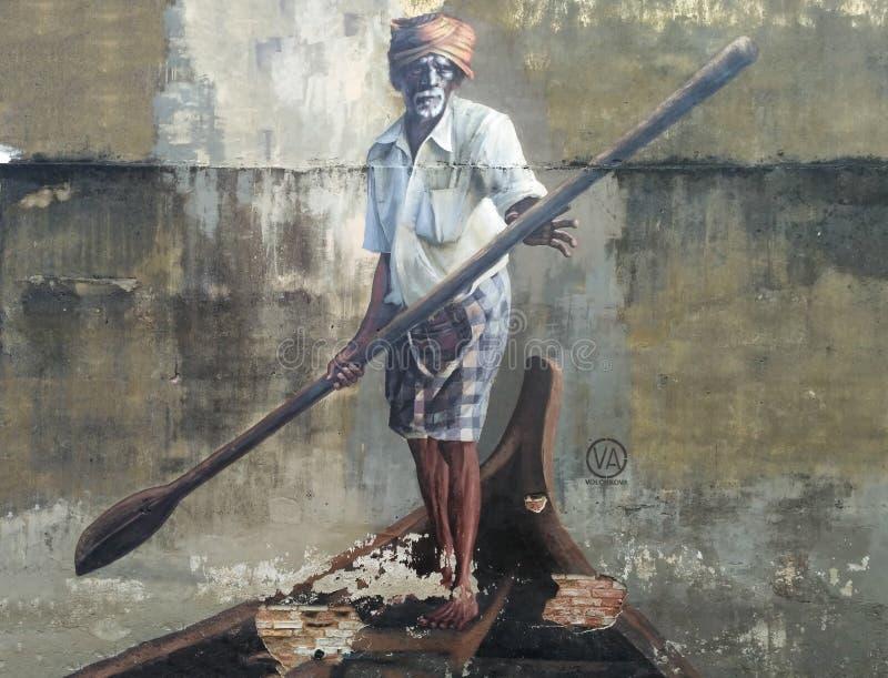 Arte público de la calle en Georgetown 'viejo hombre con una paleta en un barco ', Penang, Malasia fotografía de archivo