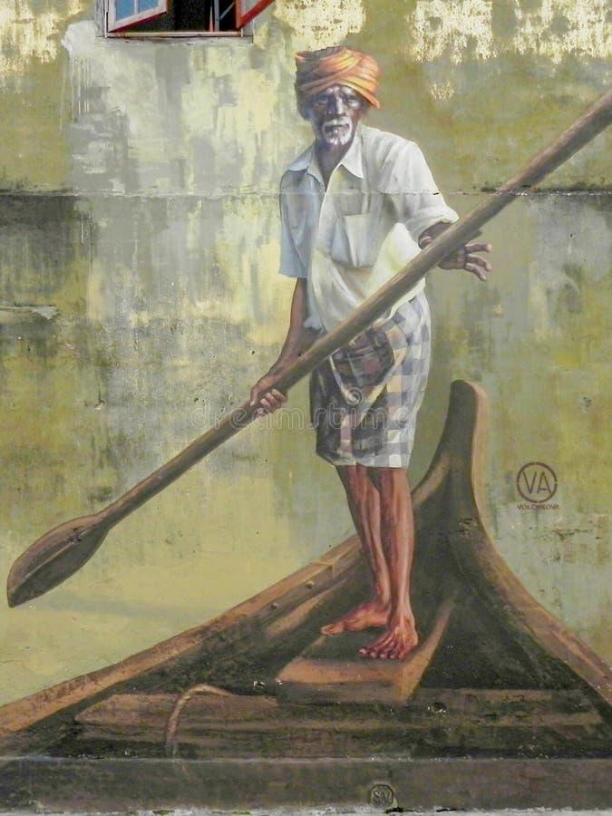 Arte público de la calle en Georgetown 'viejo hombre con una paleta en un barco ', Penang, Malasia fotografía de archivo libre de regalías